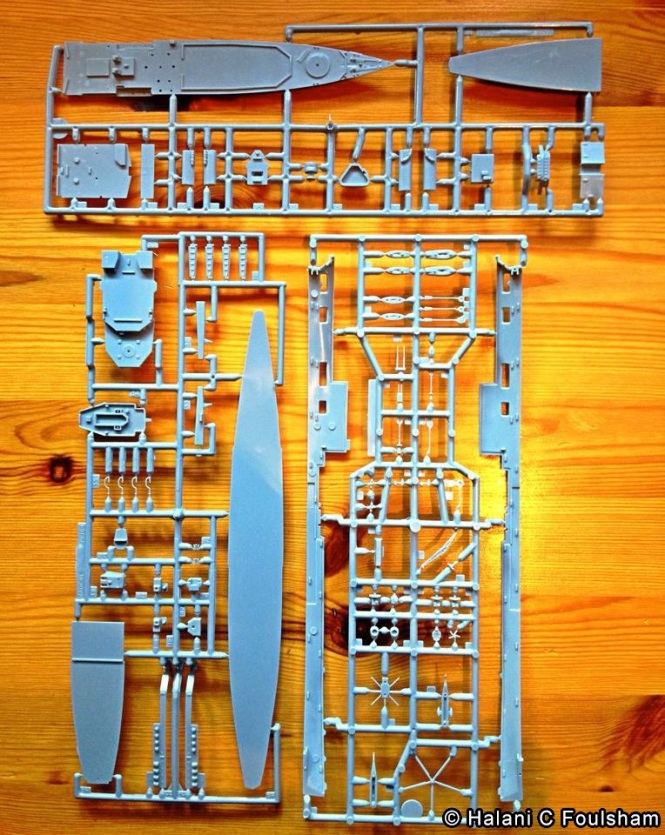 My first model kit consists of three thin grey plastic sheets from which I'll be able to pull apart the tiny pieces and configure with glue until it takes the shape of HMS Tiger.